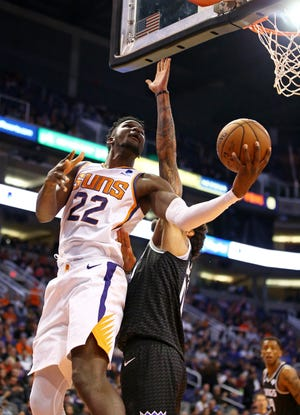 Suns center Deandre Ayton puts up a shot against the Kings during the first half of a game Tuesday at Talking Stick Resort Arena.