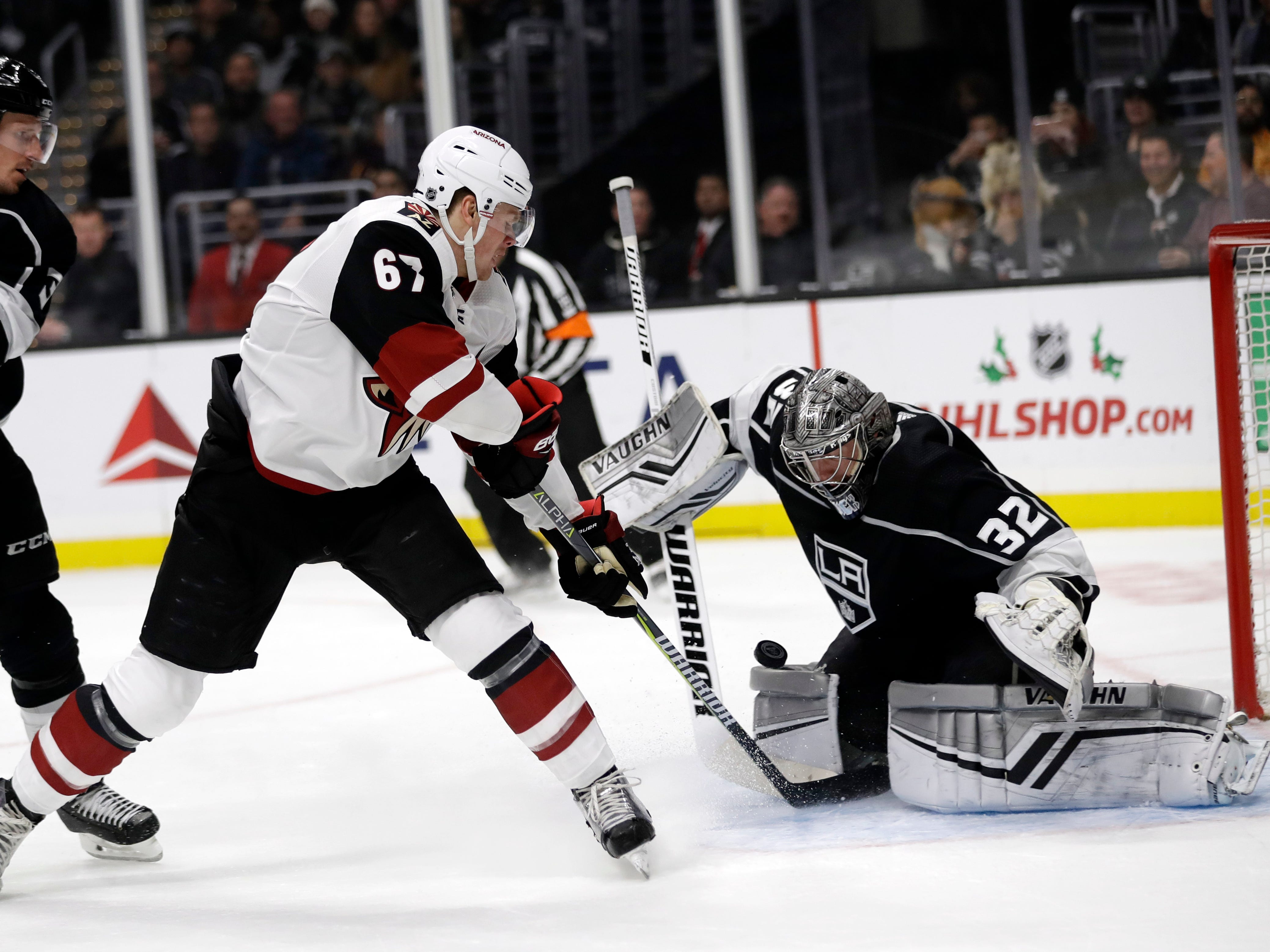 Arizona Coyotes' Lawson Crouse, center, scores past Los Angeles Kings goaltender Jonathan Quick (32) during the first period of an NHL hockey game Tuesday, Dec. 4, 2018, in Los Angeles.
