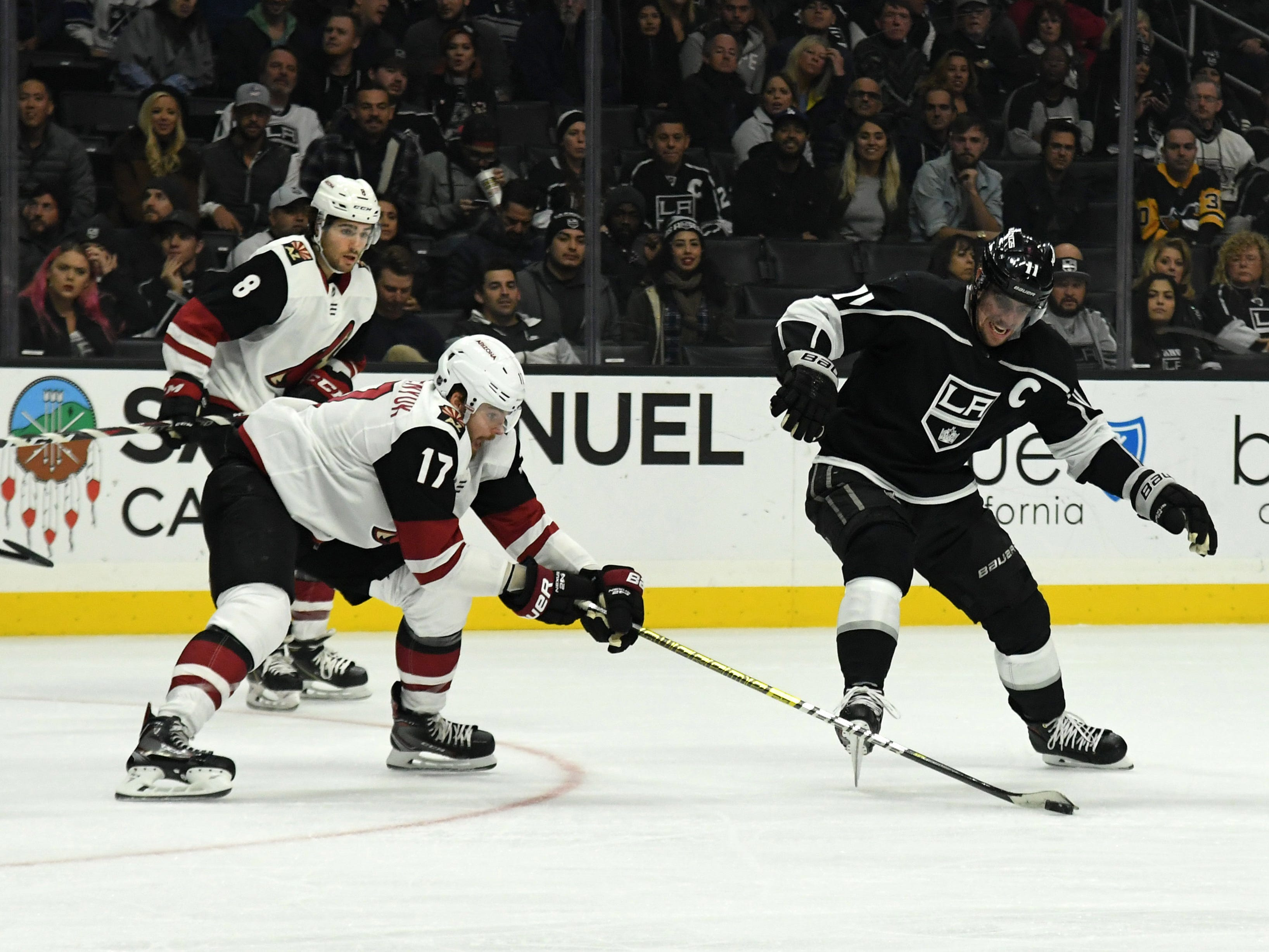 Dec 4, 2018; Los Angeles, CA, USA; Arizona Coyotes center Alex Galchenyuk (17) and Los Angeles Kings center Anze Kopitar (11) battle for the puck in the first period at Staples Center. Mandatory Credit: Kirby Lee-USA TODAY Sports