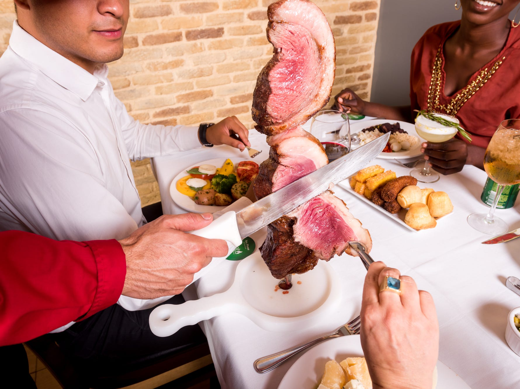 "Galeto Brazilian Steakhouse offers diners a traditional ""churrasco"" dining experience with barbecued meats carved table side."