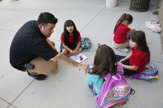 Armando Avelino, a program specialist, works with kids at ICAN, an after-school program in Chandler on Nov. 20, 2018.