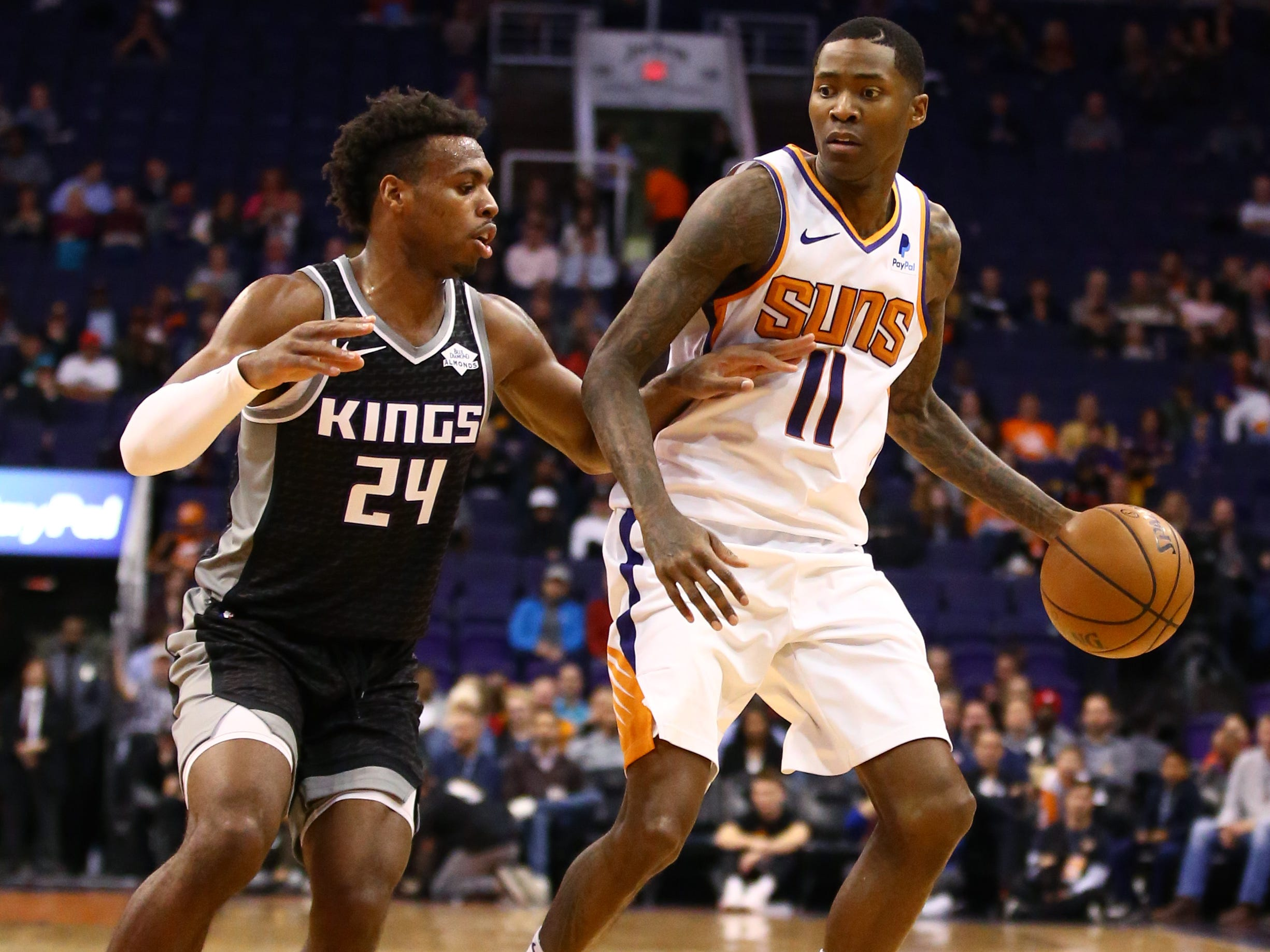 Dec 4, 2018; Phoenix, AZ, USA; Phoenix Suns guard Jamal Crawford (11) controls the ball against Sacramento Kings guard Buddy Hield (24) in the first half at Talking Stick Resort Arena. Mandatory Credit: Mark J. Rebilas-USA TODAY Sports