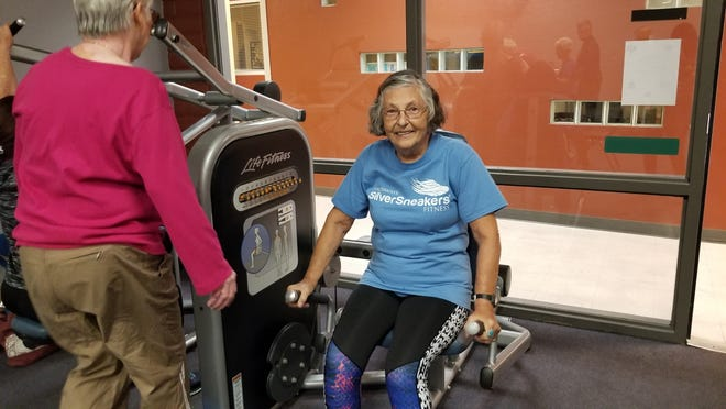 Kathie Bellinger, 78, works out at the Mesa Family YMCA in downtown Mesa on Nov. 28.