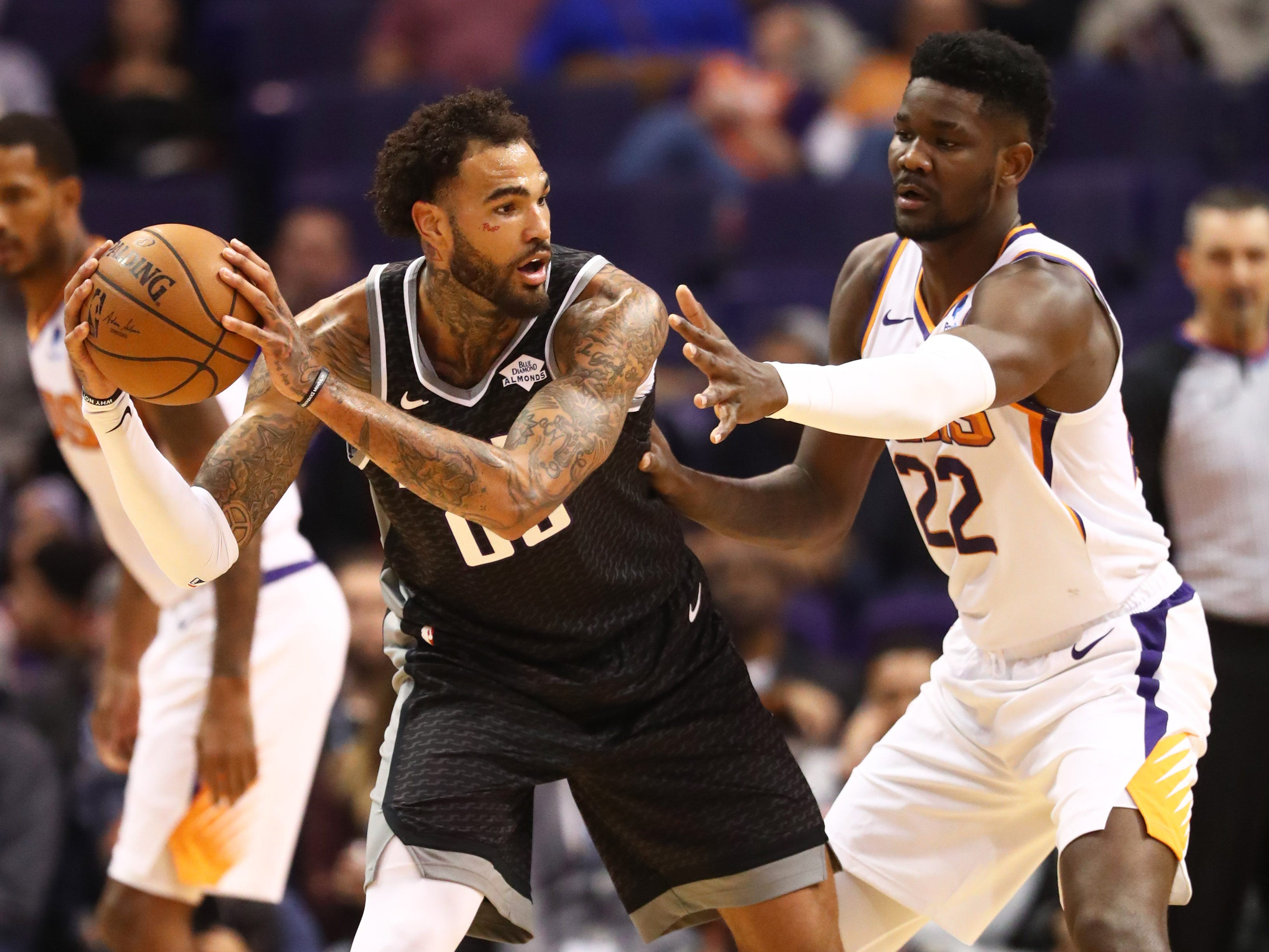 Dec 4, 2018; Phoenix, AZ, USA; Sacramento Kings center Willie Cauley-Stein (left) controls the ball against Phoenix Suns center Deandre Ayton in the first half at Talking Stick Resort Arena. Mandatory Credit: Mark J. Rebilas-USA TODAY Sports