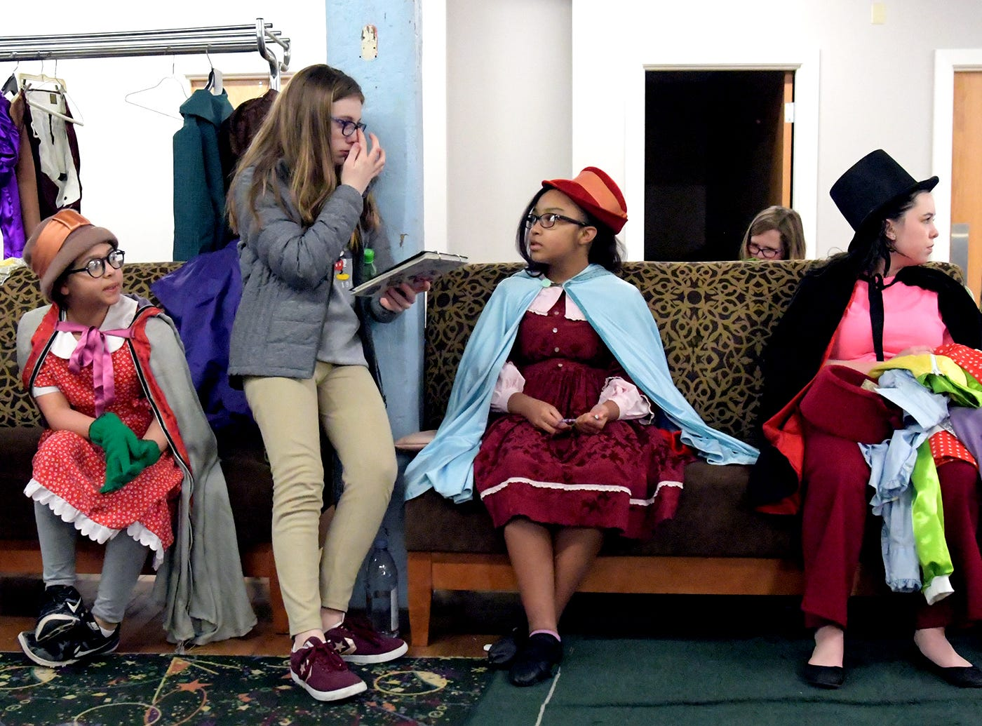 "Cast members chat before a dress rehearsal for ""A Seussified Christmas Carol"" at DreamWrights Tuesday, Dec. 4, 2018. The dual-cast performance presents twelve shows from Dec. 7 through 22 with matinee and evening start times. For show times and dates, go to dreamwrights.org. Bill Kalina photo"