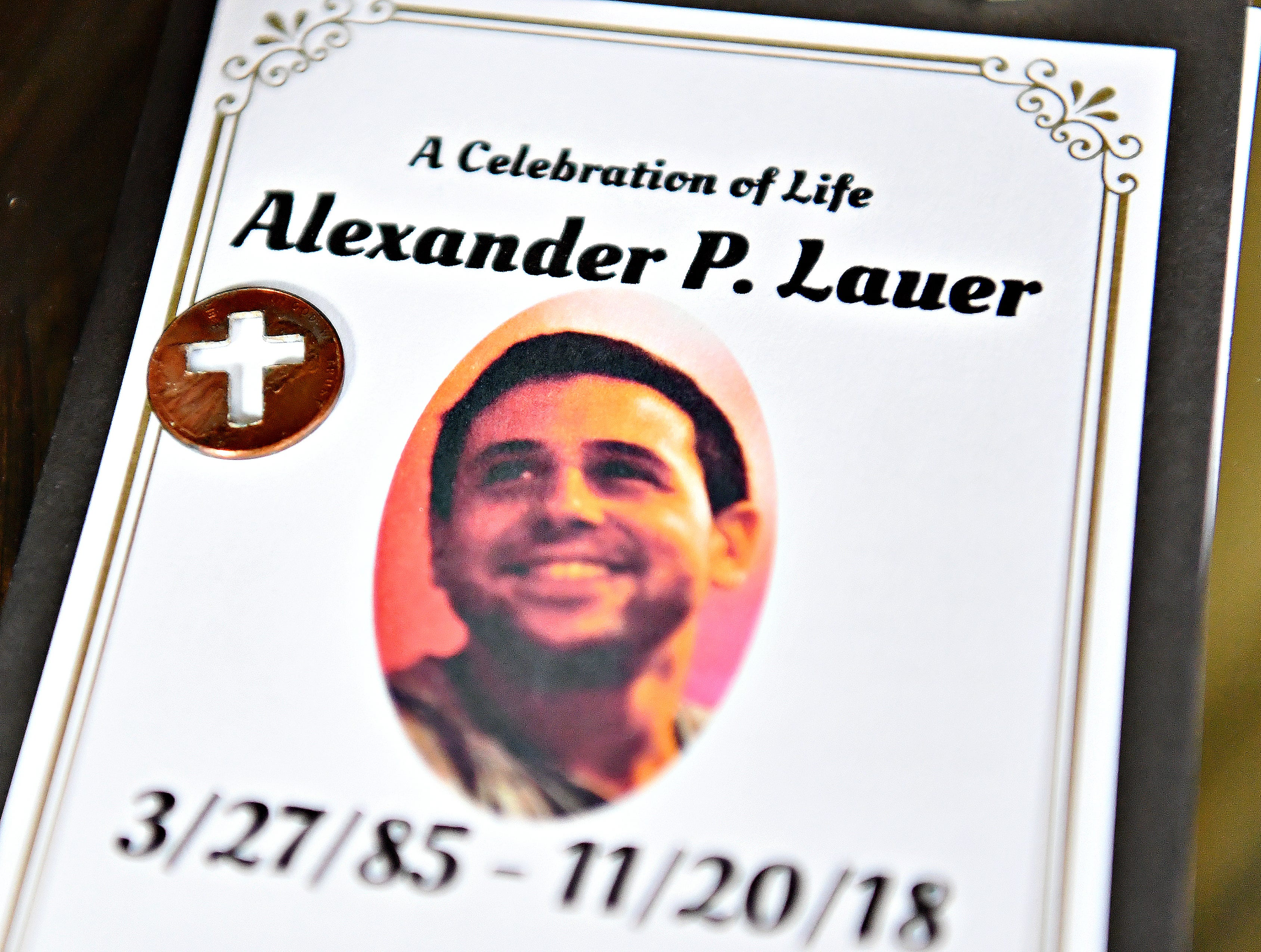 The program for the Celebration of Life held in memory of Alexander P. Lauer rests among photo albums, journals and a plethora of notes and other research materials span the kitchen table at the Lauer home in York Township, Tuesday, Dec. 4, 2018. The materials belonged to Alexander Lauer, 33, who lost his decade-long battle with heroin unexpectedly on Nov. 20., just one week after being released from York Hospital for drug treatment. Dawn J. Sagert photo