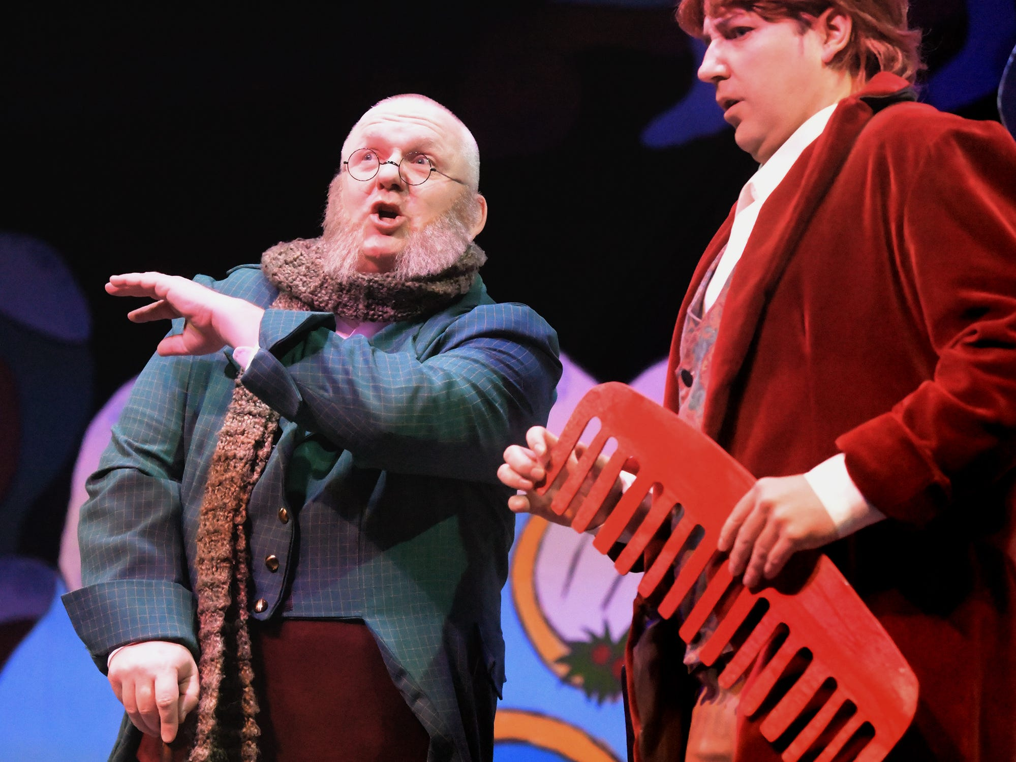 "Dan Gilbert of Red Lion, left, plays Scrooge in a scene with Scrooge's nephew played by Quinton Laughman of York City during a dress rehearsal for ""A Seussified Christmas Carol"" at DreamWrights Tuesday, Dec. 4, 2018. The dual-cast performance presents twelve shows from Dec. 7 through 22 with matinee and evening start times. For show times and dates, go to dreamwrights.org. Bill Kalina photo"