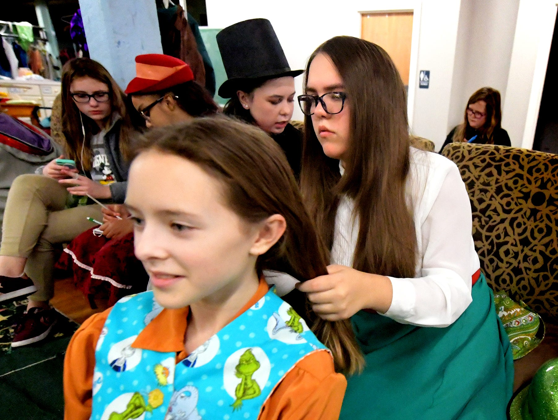"Narrator Morgan Burkhardt, 12, of Springettsbury Township, gets prepared with help from actor Skylar Newman, 13, of West Manchester Township, before a dress rehearsal for ""A Seussified Christmas Carol"" at DreamWrights Tuesday, Dec. 4, 2018. The dual-cast performance presents twelve shows from Dec. 7 through 22 with matinee and evening start times. For show times and dates, go to dreamwrights.org. Bill Kalina photo"