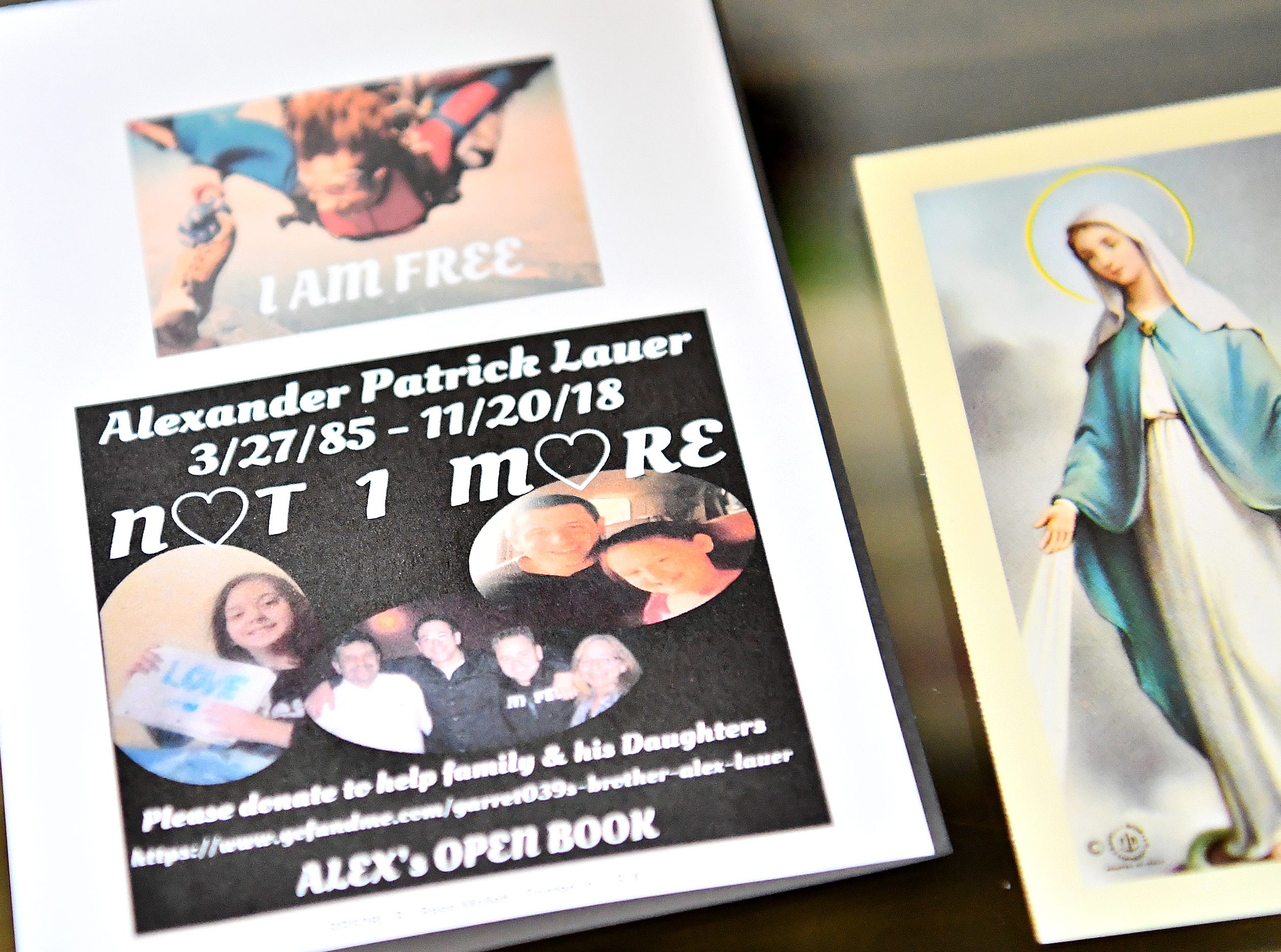 The Lauer family looks through photo albums, journals and a plethora of notes and other research materials at their home in York Township, Tuesday, Dec. 4, 2018. The materials belonged to Alexander Lauer, 33, who lost his decade-long battle with heroin unexpectedly on Nov. 20., just one week after being released from York Hospital for drug treatment. Dawn J. Sagert photo