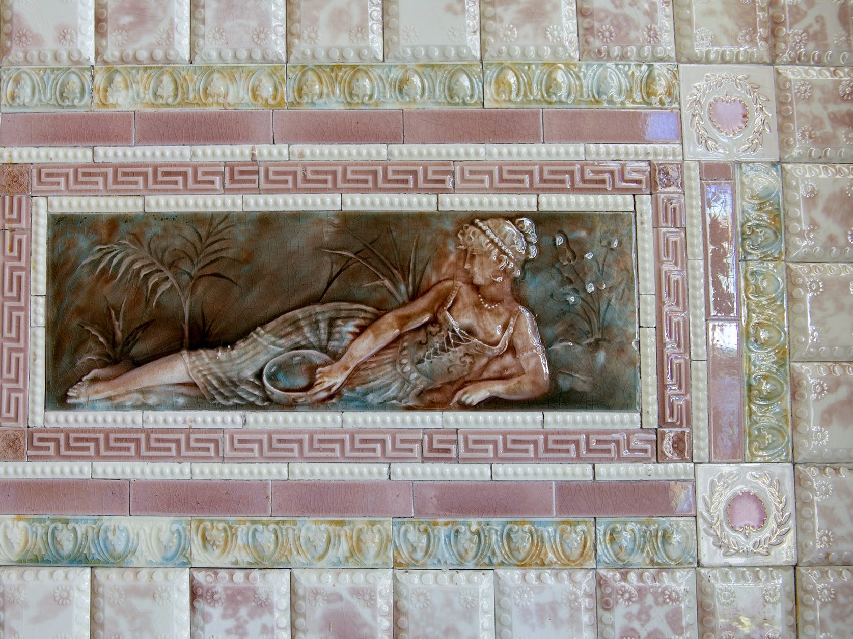 Italian tile in the front foyer surrounds a painted tile picture.