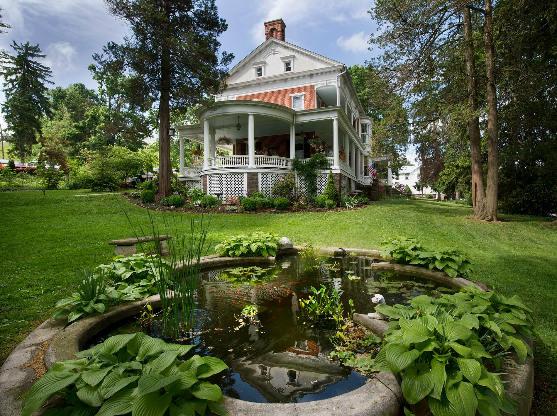The fish pond frames the front lawn of The Emig Mansion Bed & Breakfast on Sunday May 17, 2015.
