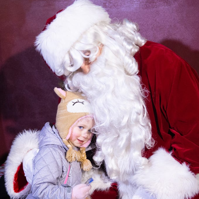 Children cuddle up to Santa Claus at Christmas Magic 2018 at Rocky Ridge County Park in Springettsbury Township.