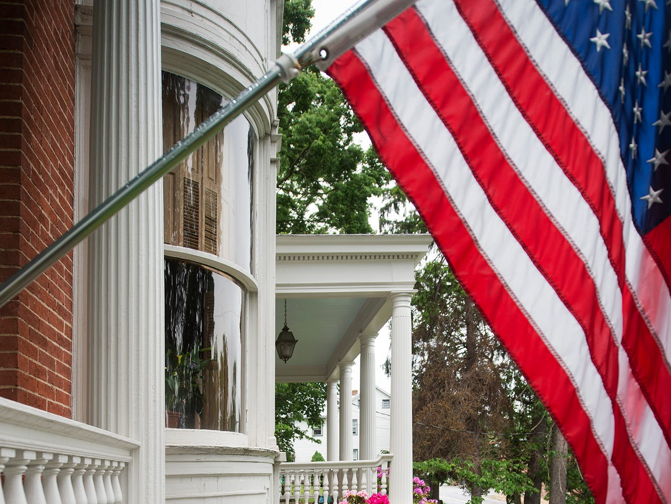 A flag waves in the spring breeze on the front porch of the Emig Mansion Bed & Breakfast on Sunday May 17, 2015.