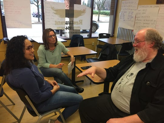 York XL board director Thais Carrero, left, exchanges a few words with Robin Shearer and John Bear. The organization holds an 8-week Spanish class in York.