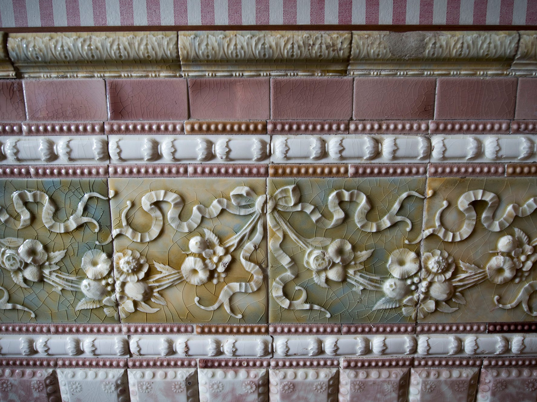 Italian tile in the front entry hall at the Emig Mansion Bed & Breakfast catches light at different angles in May 2015.