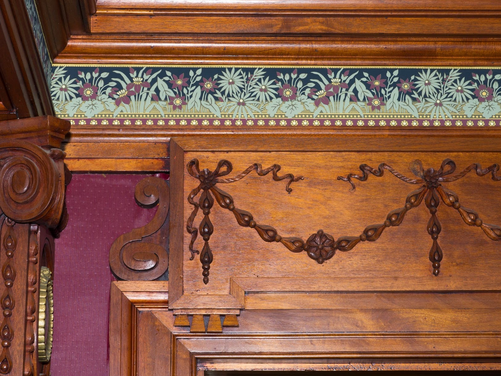 Carved and paneled wood surrounds the interior of the Emig Mansion dining room.