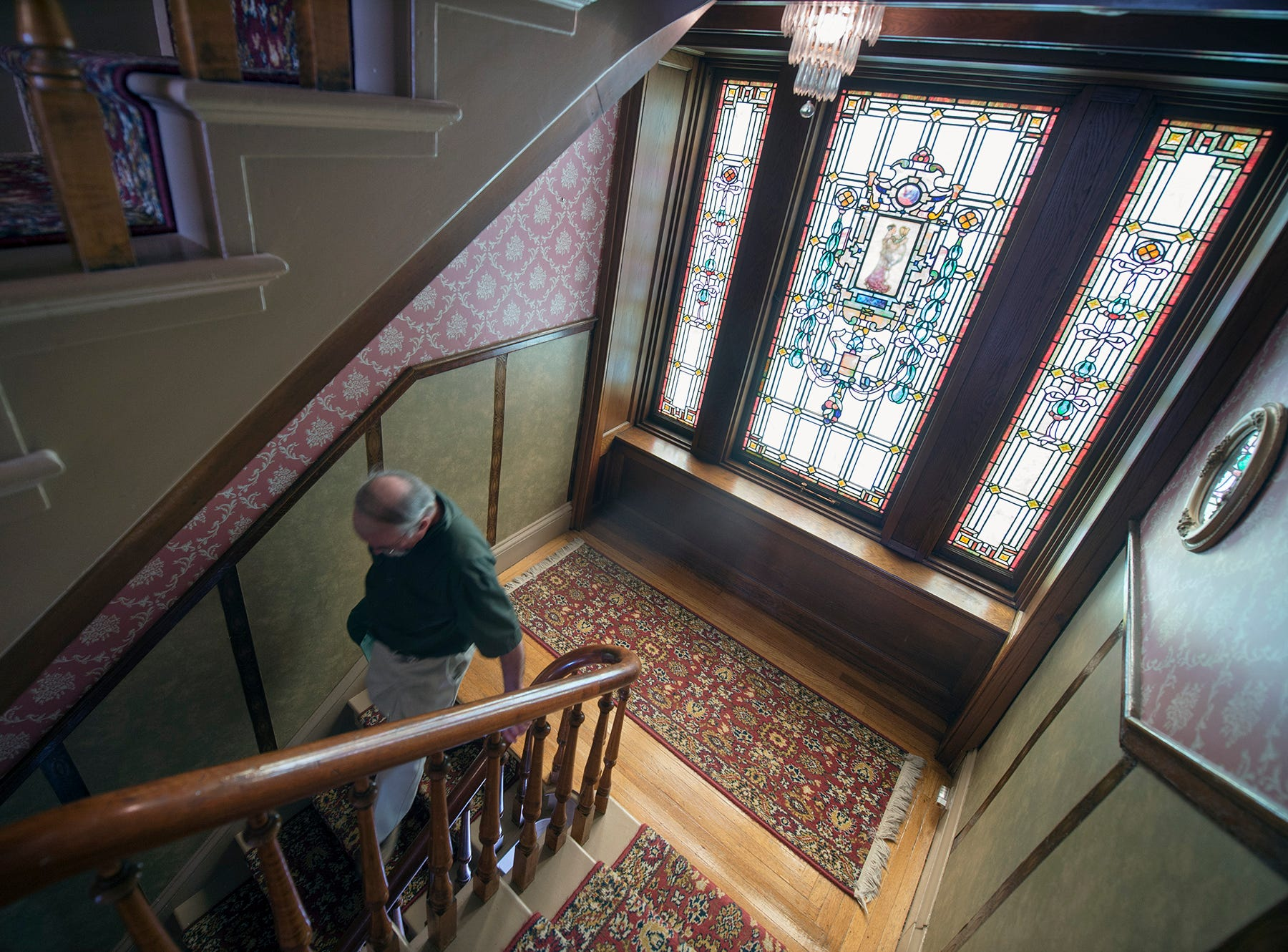 Light from stained glass filters in on to a landing between the first and second floors of the Emig Mansion Bed & Breakfast on Sunday May 17, 2015.