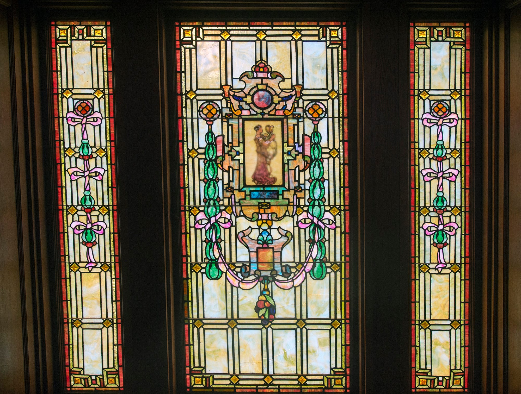The stained glass bathes the landing between the first and second floors with warm light at the Emig Mansion Bed & Breakfast May 17, 2015.