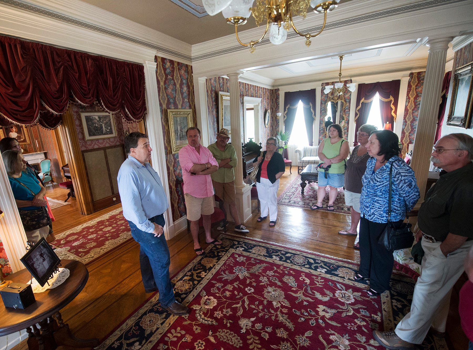 Bill Fitzell gives a tour of the parlor during an open house at the Emig Mansion Bed & Breakfast on Sunday May 17, 2015.