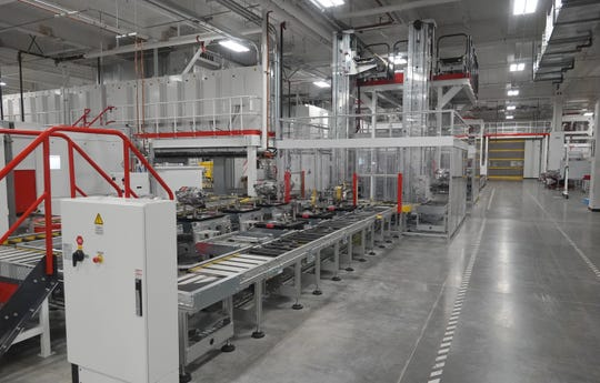 A conveyor moves drive units in the Tesla Gigafactory on Dec. 3, 2018.