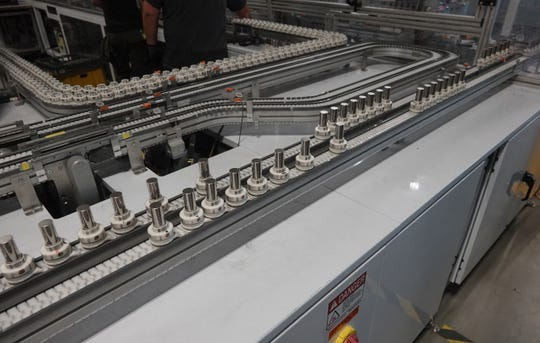 Battery cells from Panasonic on a conveyor taking them through the Tesla Gigafactory where they will be assembled into battery packs for the Model 3 or other products on Dec. 3, 2018.
