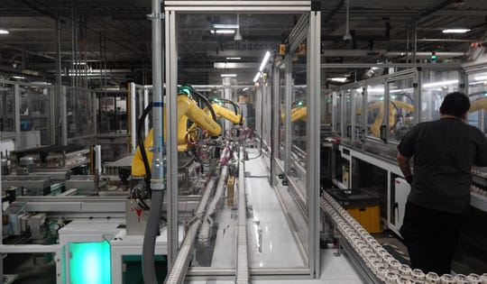 Robots at the Tesla Gigafactory help assemble battery cells from Panasonic into battery packs for Tesla's Model 3 sedan and other products on Dec. 3, 2018.