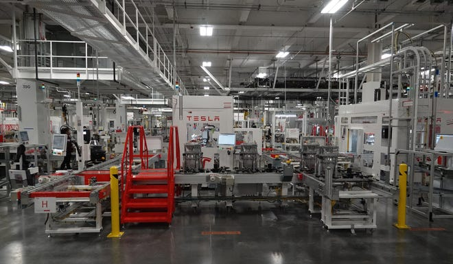 Machines do an estimated 90 percent of the work in the drive unit manufacturing area of the Tesla Gigafactory outside Reno, Nevada.