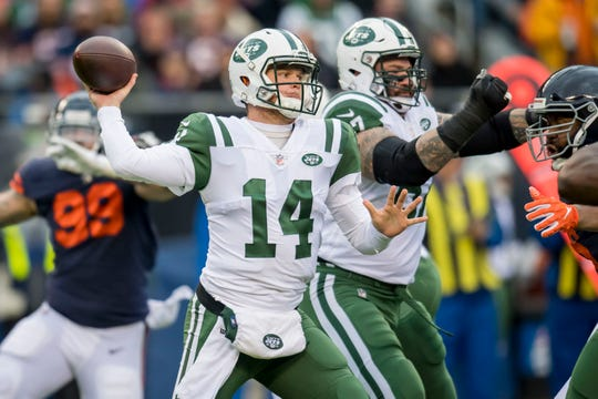 New York Jets quarterback Sam Darnold (14) passes against the Chicago Bears during the first half at Soldier Field.