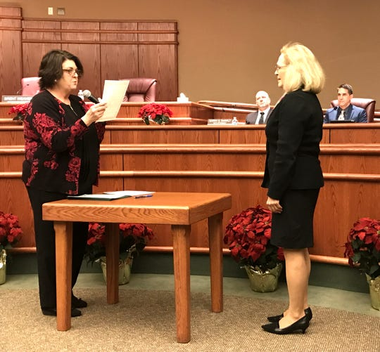 City Clerk Pam Mize gives the oath of office to Kristen Schreder, right, on Tuesday night. Schreder, the former mayor, was elected to a new term on the Redding City Council.