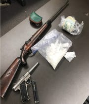 These guns and drugs were allegedly found in a home on Shasta Dam Boulevard on Tuesday.