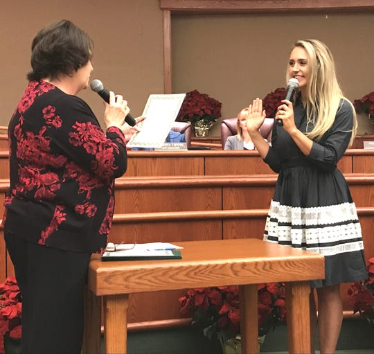 City Clerk Pam Mize gives the oath of office to new Redding City Council member Erin Resner, right, on Tuesday night.