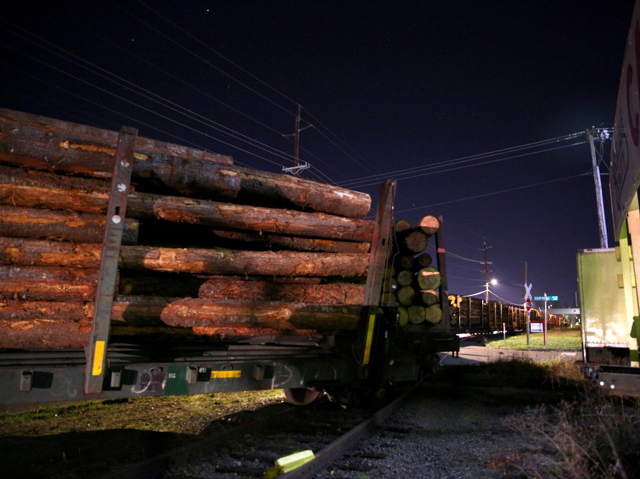 A train carrying logs derailed just north of downtown Salem on Tuesday, Dec. 4.
