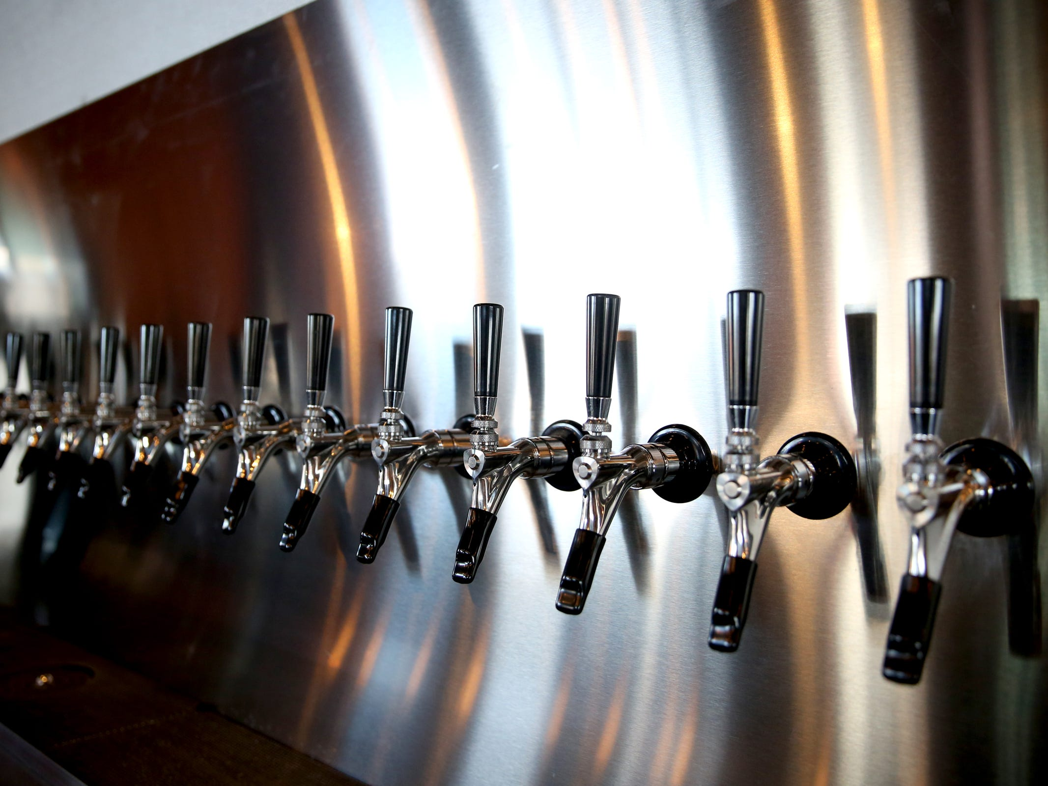 Taps for craft beer, nitro cold brew coffee, hard cider and kombucha at The Yard Food Park in Salem on Wednesday, Dec. 5, 2018. When it opens, The Yard will essentially be part coffee shop, part bar, part event space, and part food truck food court.