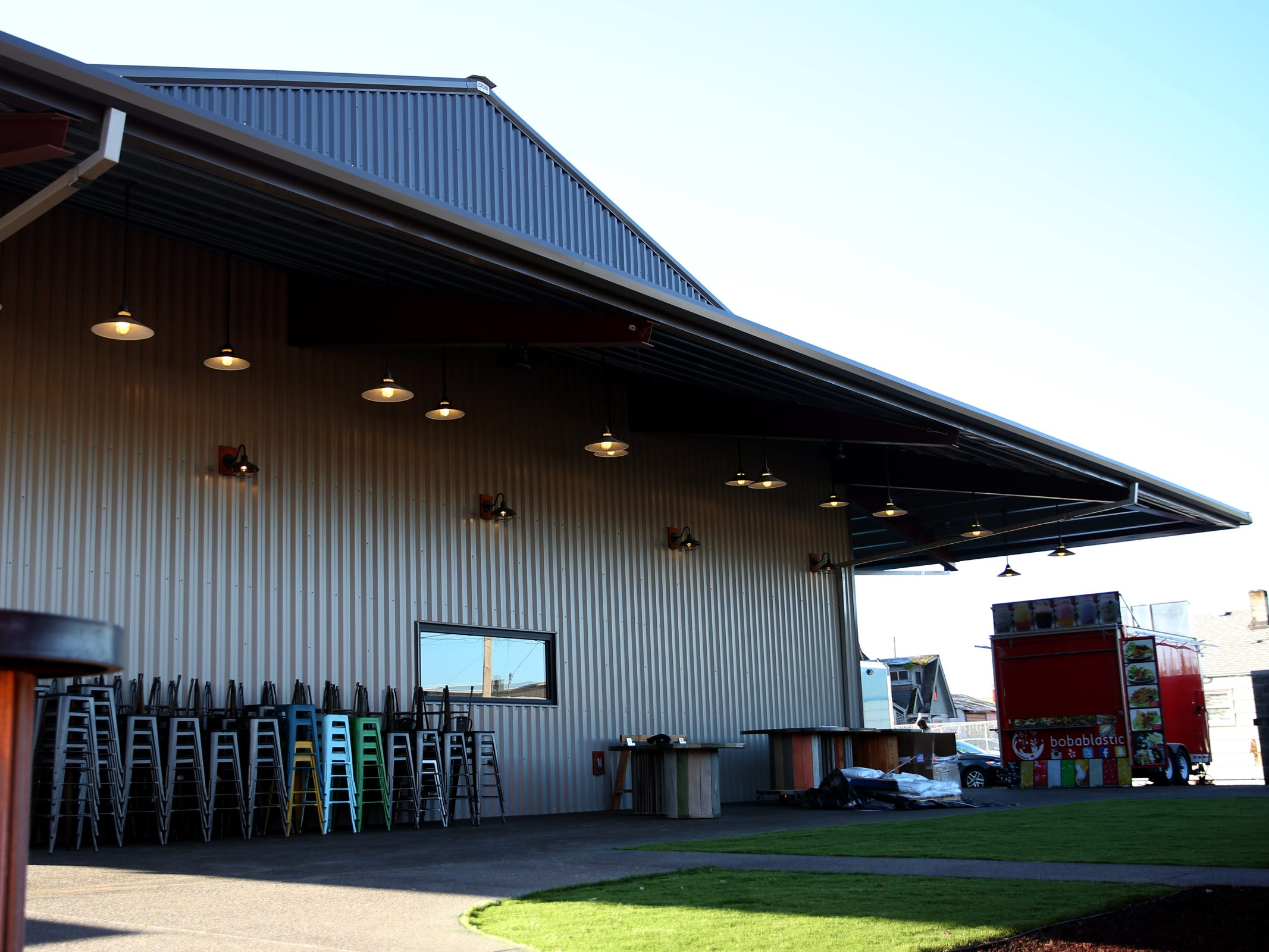 An outdoor seating and yard game area at The Yard Food Park in Salem on Wednesday, Dec. 5, 2018. When it opens, The Yard will essentially be part coffee shop, part bar, part event space, and part food truck food court.