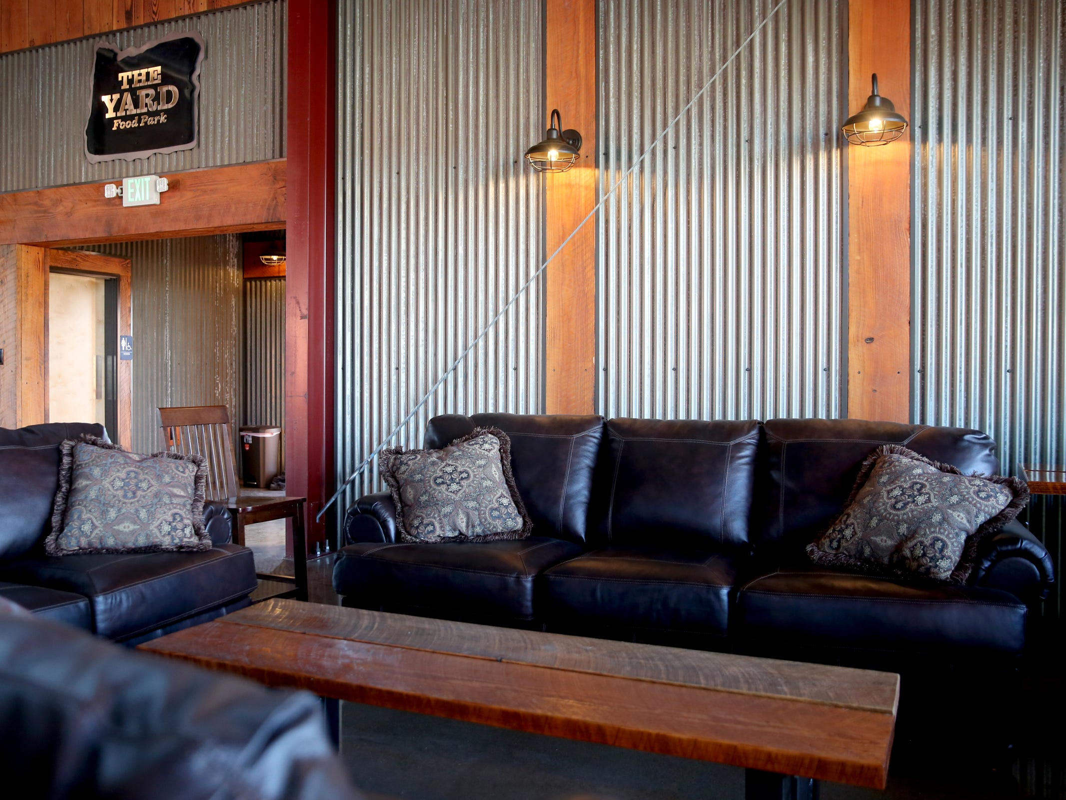 A seating area with couches at The Yard Food Park in Salem on Wednesday, Dec. 5, 2018. When it opens, The Yard will essentially be part coffee shop, part bar, part event space, and part food truck food court.