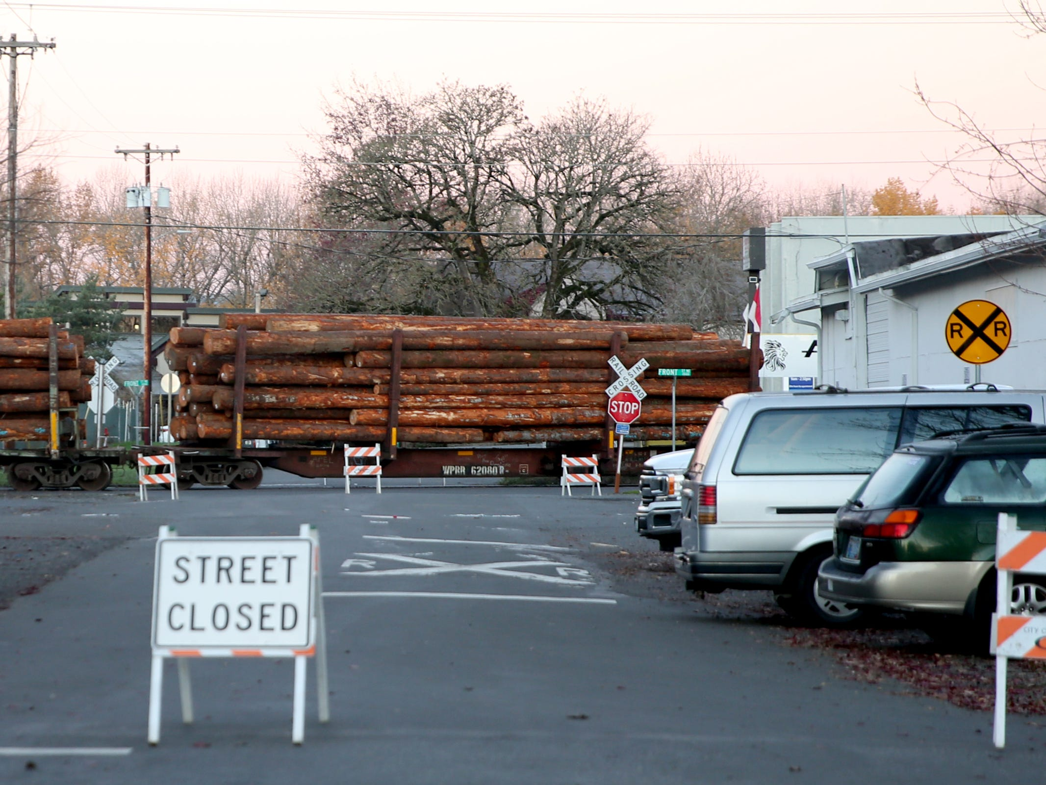 Crews work to clear the scene after a log train derailment in Salem on Wednesday, Dec. 5, 2018. Front St. NE from Norway to D Streets NE are closed following the derailment Tuesday night.