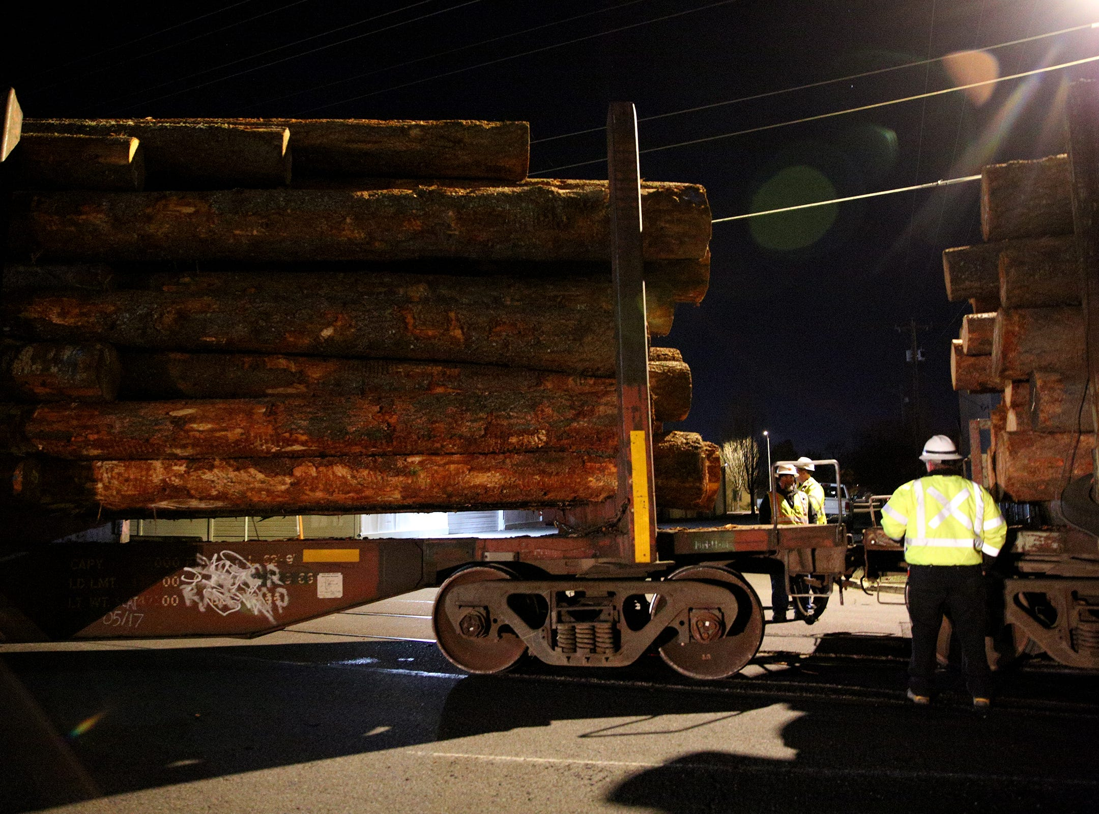 Crew members work to clean up a train that derailed carrying logs just north of downtown Salem on Tuesday, Dec. 4.