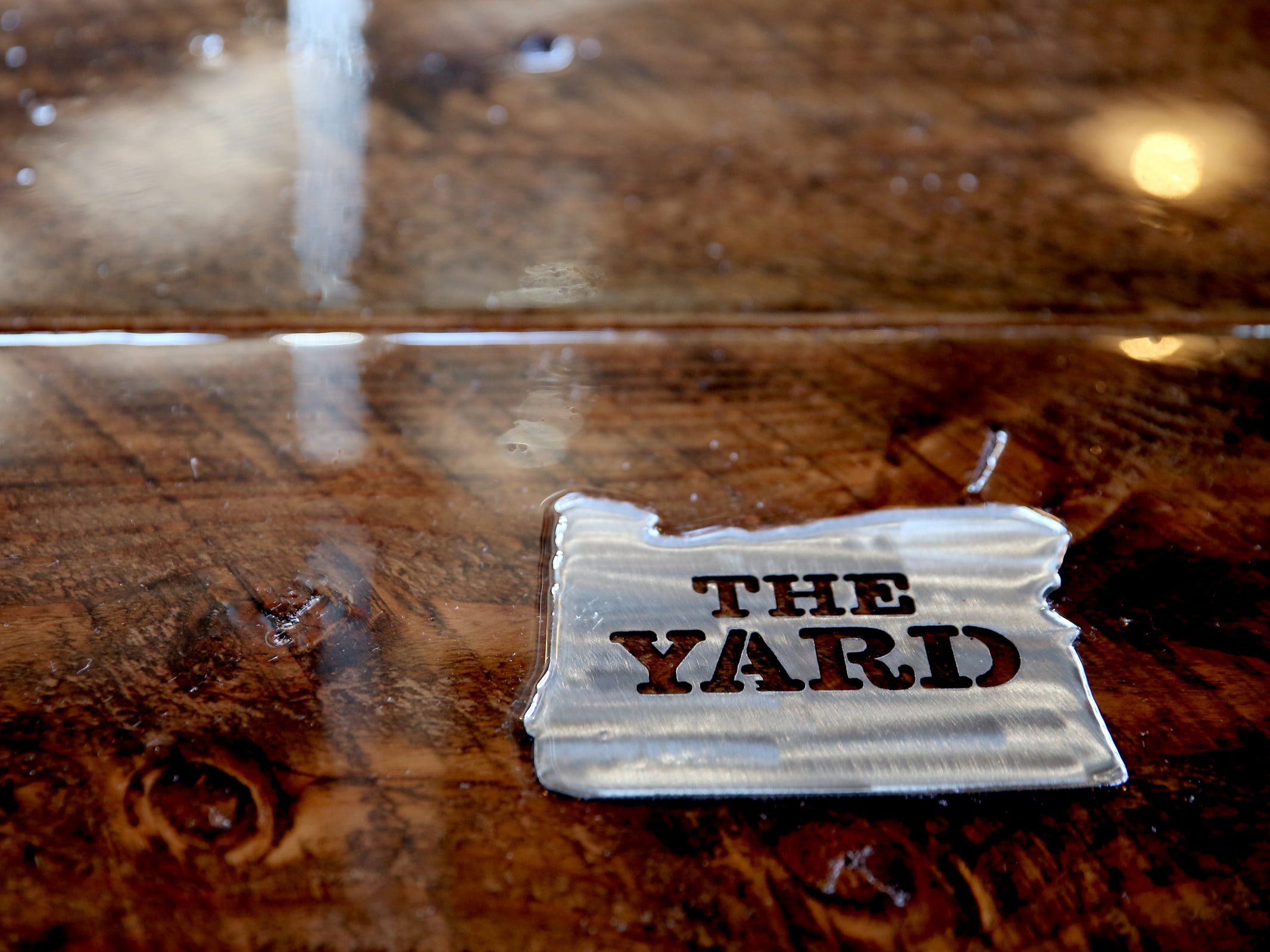 A detail embedded in a table at The Yard Food Park in Salem on Wednesday, Dec. 5, 2018. When it opens, The Yard will essentially be part coffee shop, part bar, part event space, and part food truck food court.