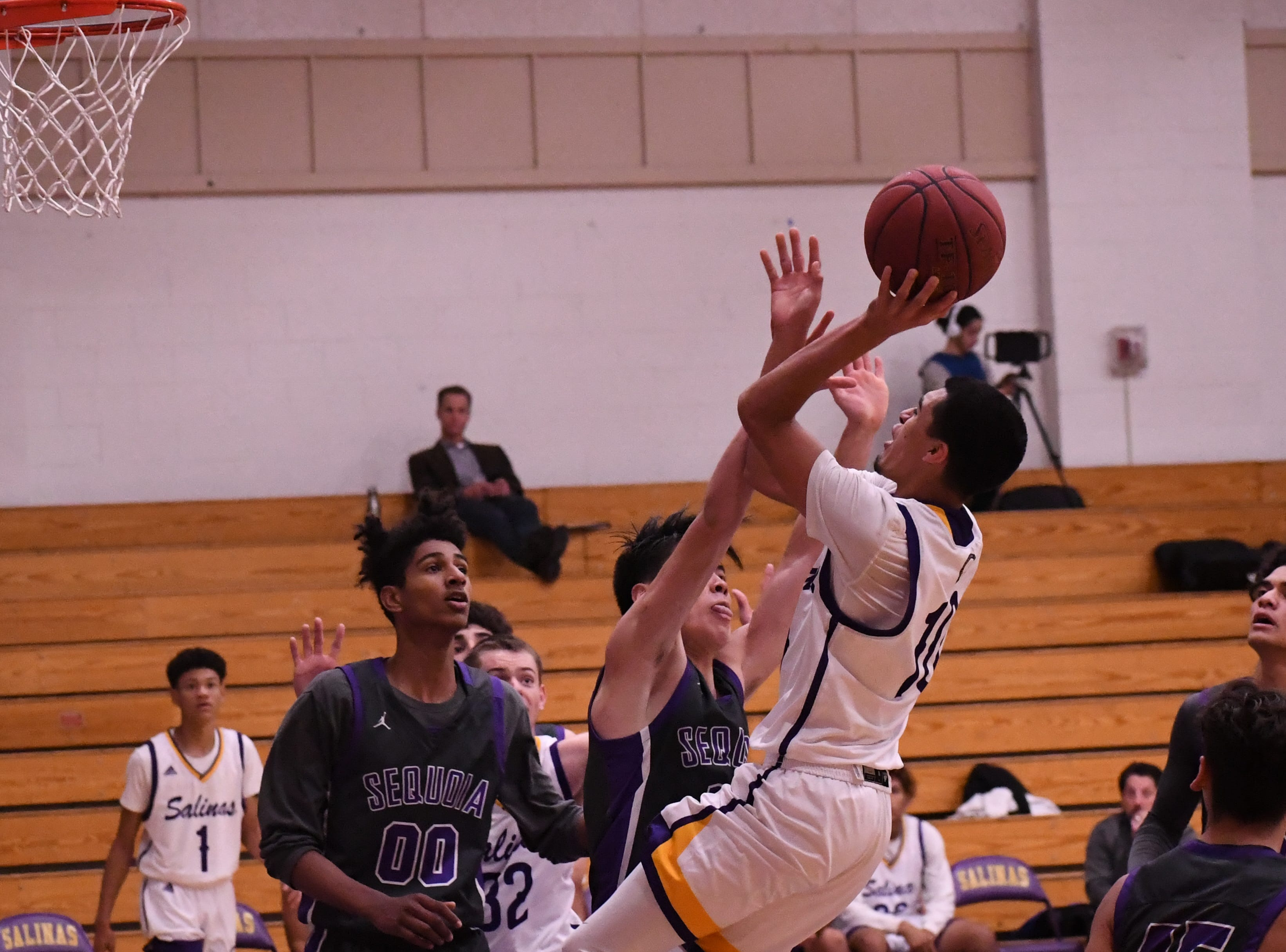 Guard AJ Saldana (10) pulls up for a shot from outside the paint.