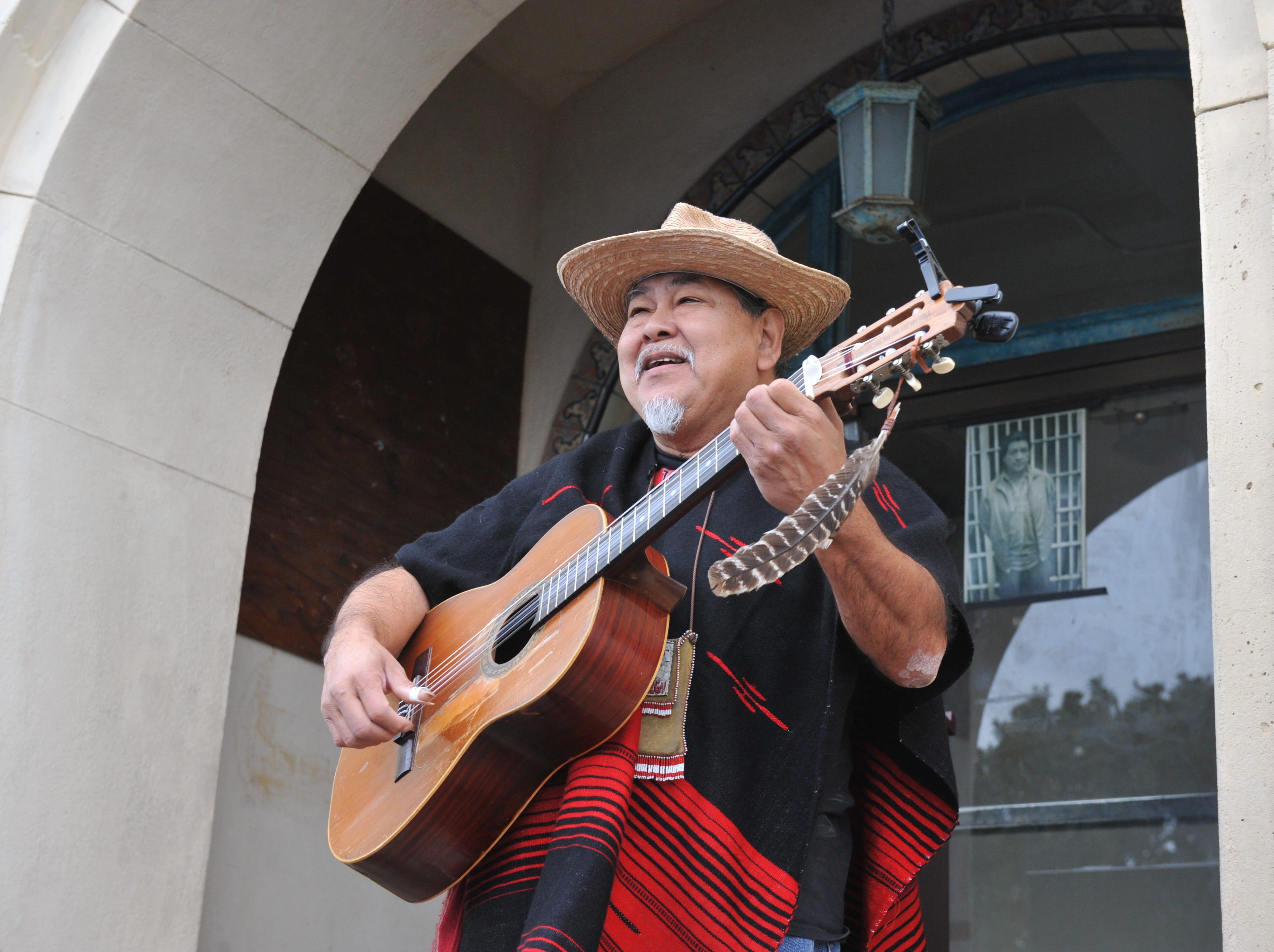 Noe Yaocoatl Montoya, 64, sings before the plaque ceremony.