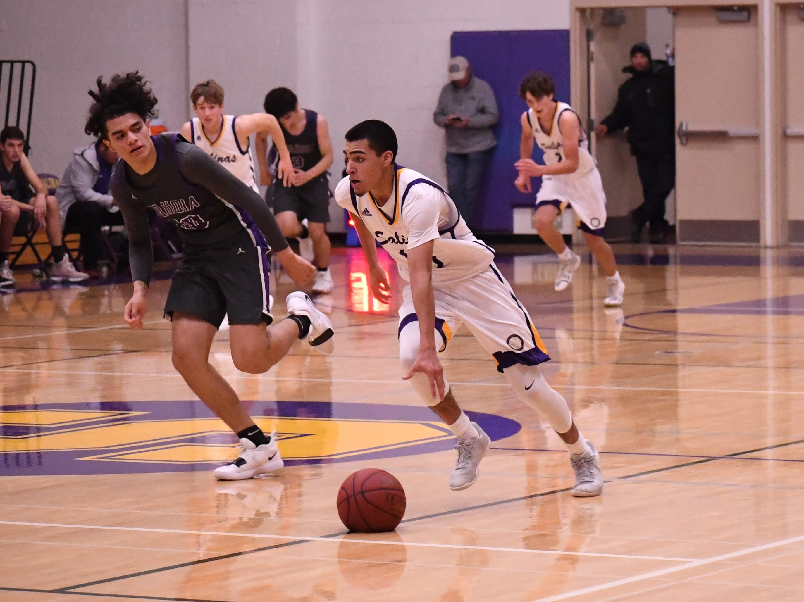 Guard AJ Saldana (10) sprints to the hoop after corralling a steal.