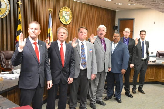 Members of the Wicomico County Council take the oath of office on Tuesday, Dec. 4, 2018. From left are Bill McCain, John Cannon, Larry Dodd, Joe Holloway, Ernie Davis, Marc Kilmer and Josh Hastings. Council members elected Cannon as president and Dodd as vice president.