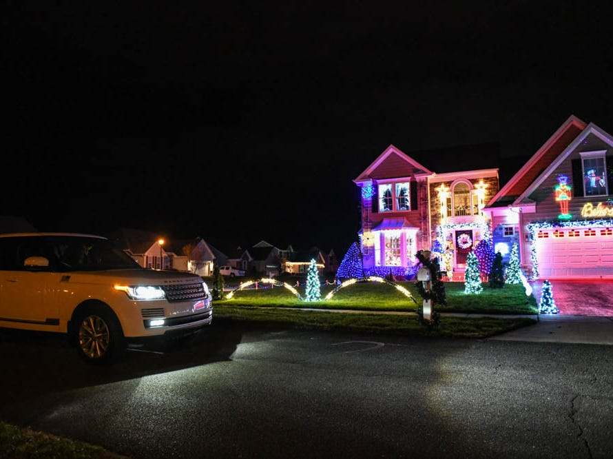 Cars stop to view 50,000 lights set to music illuminate a Lewes home for the holidays on Tuesday, Dec 4, 2018.
