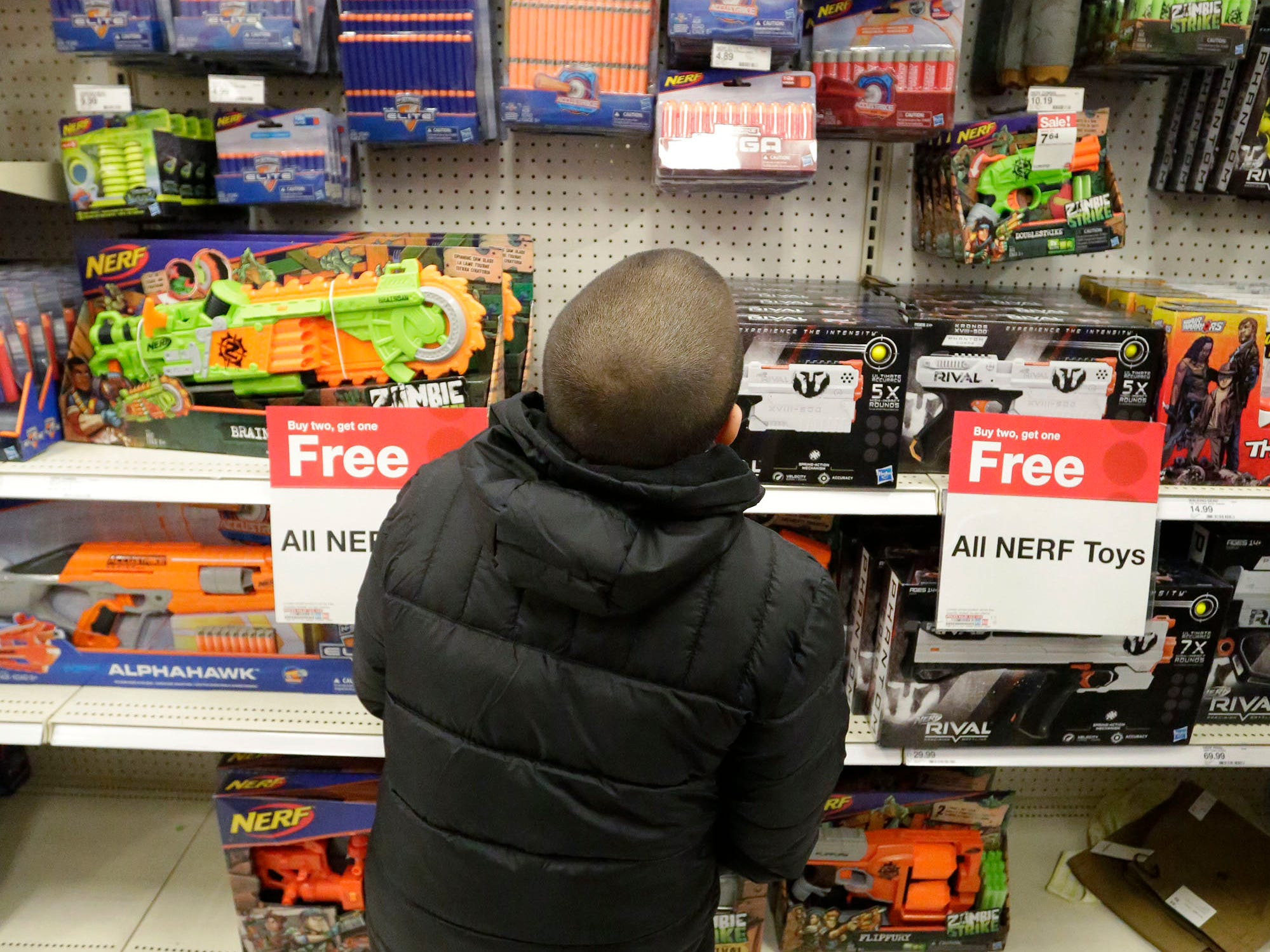 Jose Esteves, 8, of Sheboygan, Wis., examines his toy choices during Shop with a Copy, Tuesday, December 4, 2018, in Kohler, Wis. The program, in its 21st year, raises funds to give children a chance to buy holiday gifts that they otherwise might not receive.