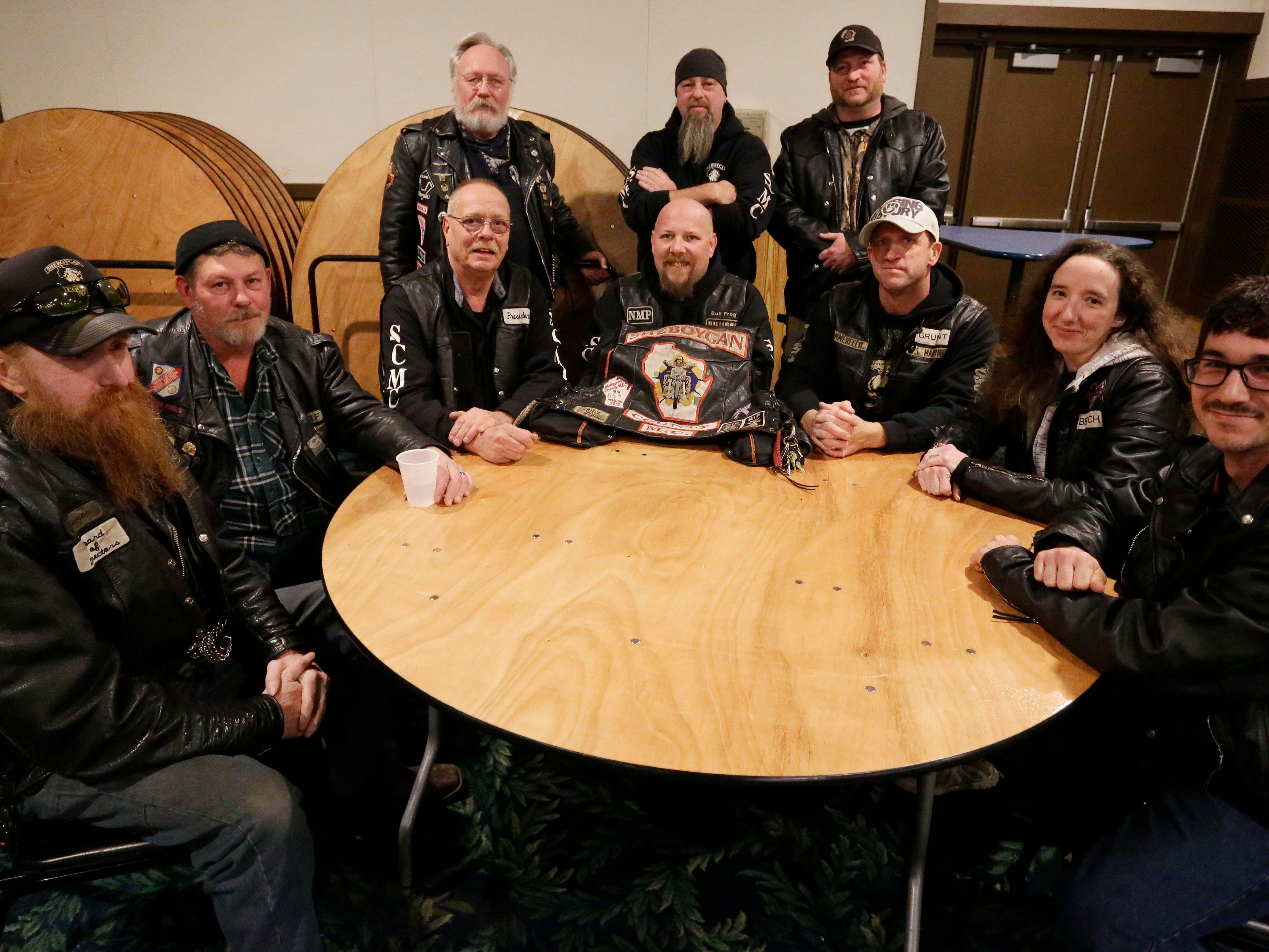 Members of the Sheboygan County Motorcycle club pose at Lakeshore Lanes, Tuesday, December 4, 2018, in Sheboygan, Wis. The club raised and donated $5,000 to the Shop with a Cop program. The program, in its 21st year, raises funds to give children a chance to buy holiday gifts that they otherwise might not receive.