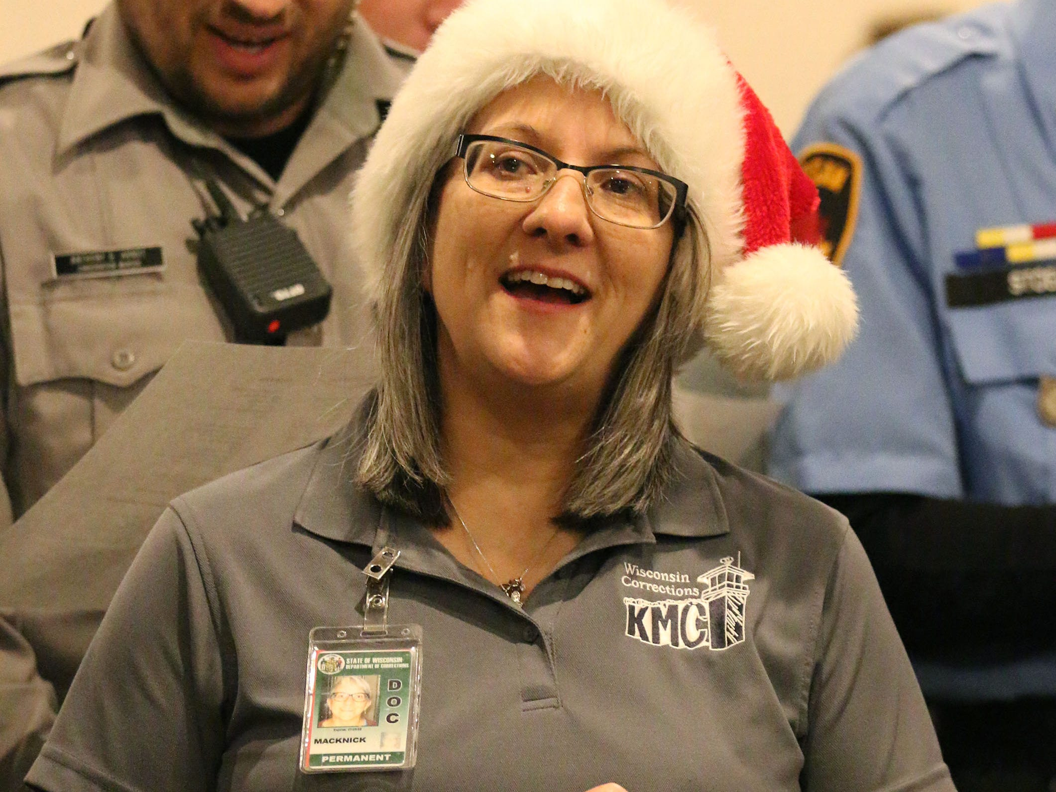 Kettle Moraine Correctional Institute social worker Betty Macknick belts out Rudolph the Red-Nosed Reindeer during the start of Shop with a copy at Lakeshore Lanes, Tuesday, December 4, 2018, in Sheboygan, Wis. The program, in its 21st year, raises funds to give children a chance to buy holiday gifts that they otherwise might not receive.