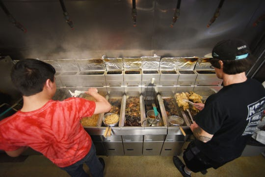 Cooks Jake Kongi, left, and Brian Scott, right, fry more chicken for the Buffett at The Keg Chicken during lunch time Tuesday, Dec. 4, at the restaurant in Sioux Falls.