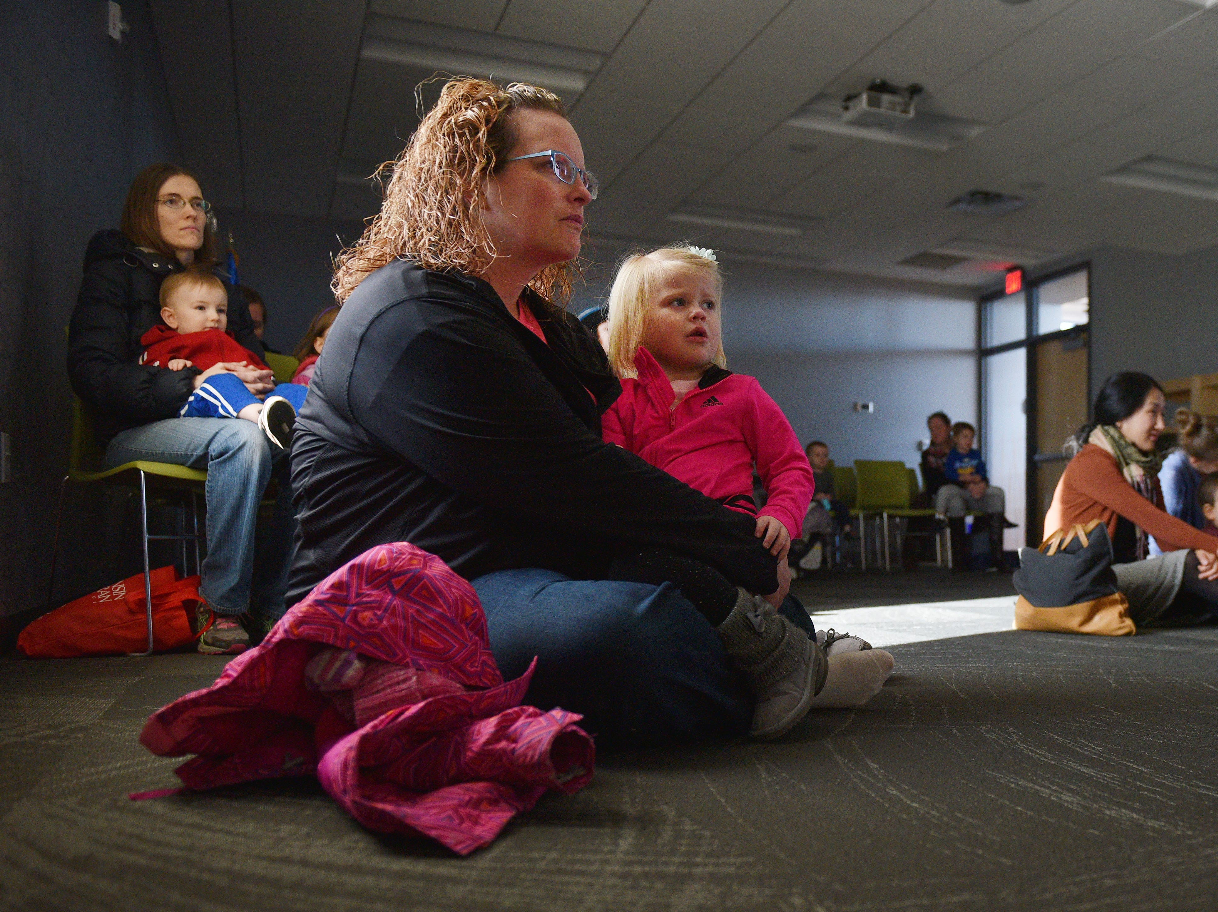Heather Pike and her daughter Haddie Jo Pike watch The Christmas Gift puppet show at the Prairie West Branch Wednesday, Dec. 5, in Sioux Falls.