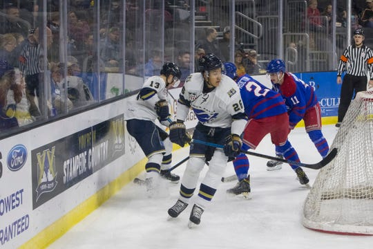 Stampede's Andre Lee (26) skates around the goal during a game against the Des Moines Buccaneers, Tuesday, Dec. 4, 2018 at the Denny Sanford Premier Center in Sioux Falls, S.D.