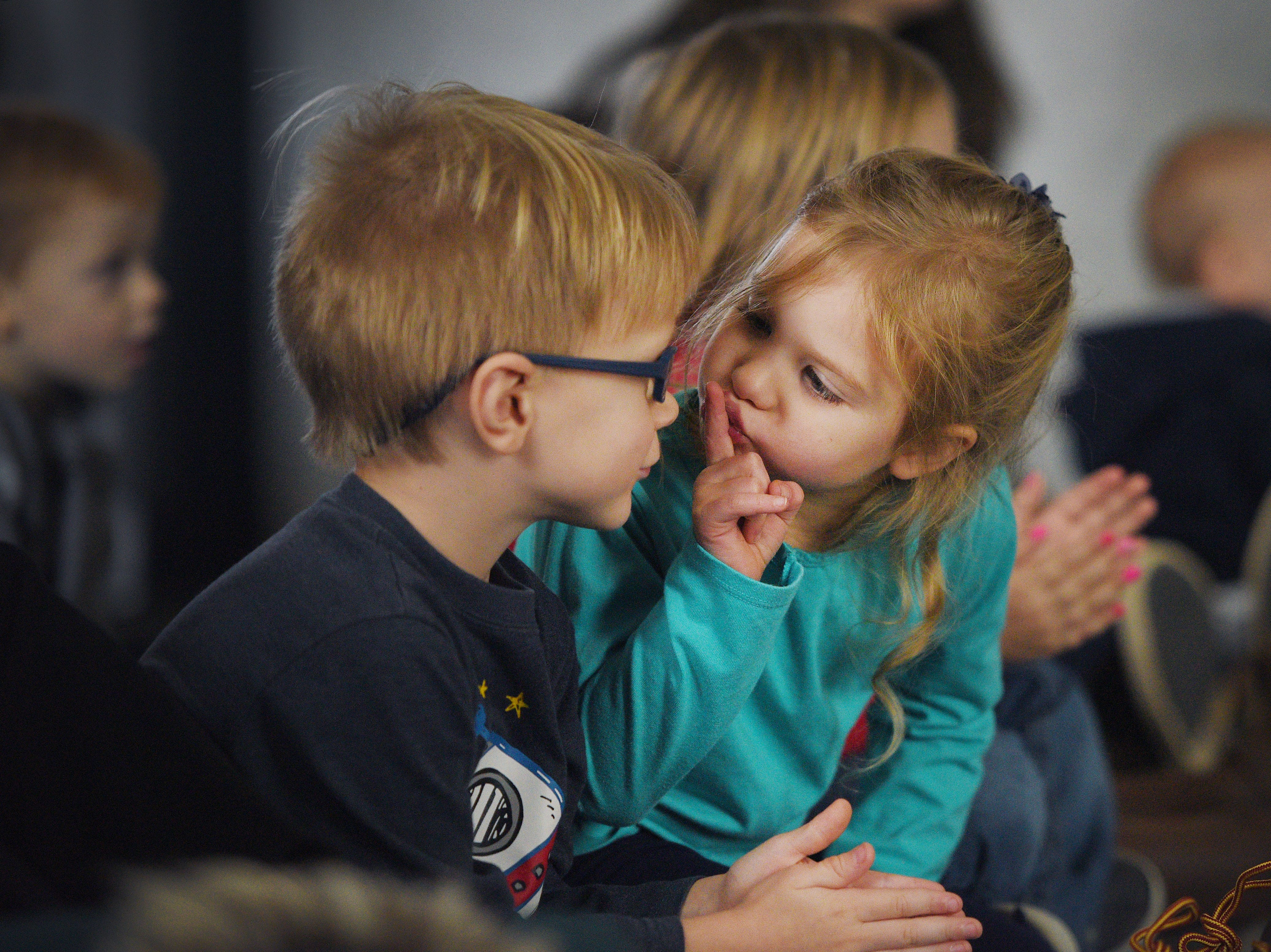 Evelyn Hoesing tells Gavin Dewit to be quiet during The Christmas Gift puppet show at the Prairie West Branch Wednesday, Dec. 5, in Sioux Falls.